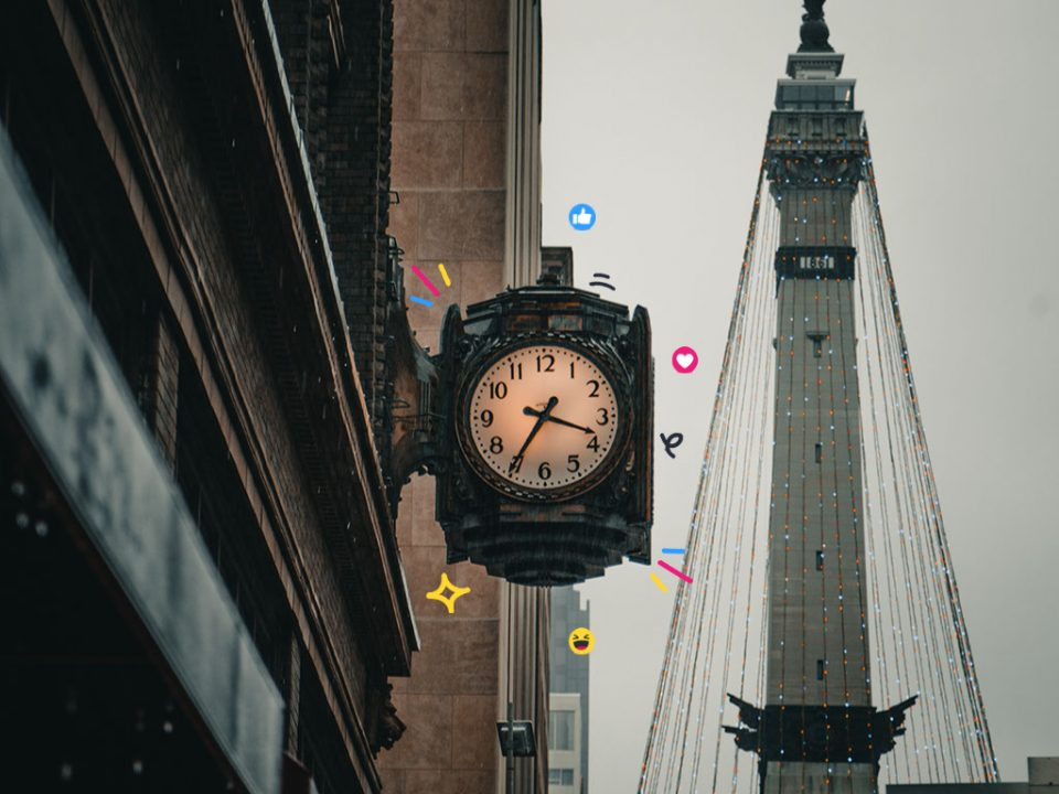 An old clock on the side of a building, surrounded by social media icons
