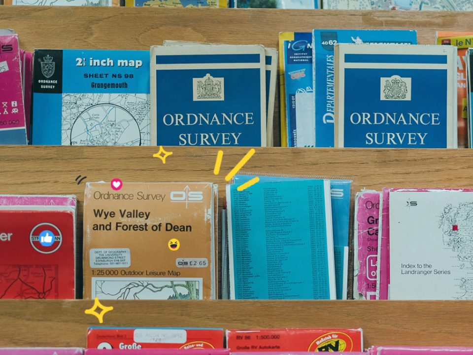 A shelf of old Ordnance Survey maps, representing local SEO. The shelf prominently features a map for the Wye Valley and Forest of Dean
