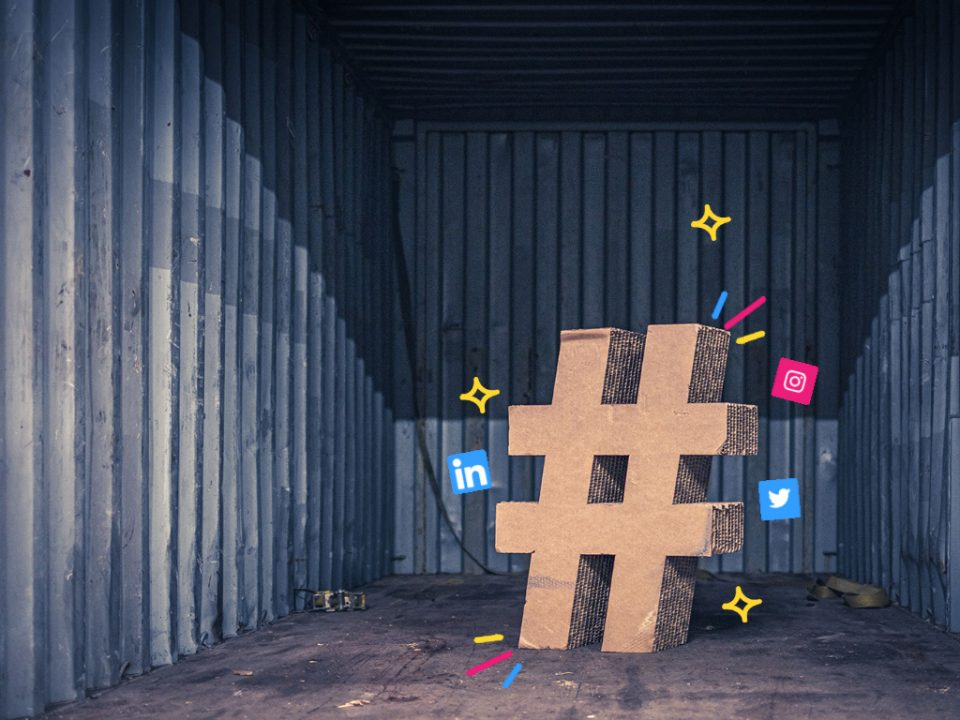 A large cardboard hashtag, surrounded by icons representing Twitter, LinkedIn and Instagram