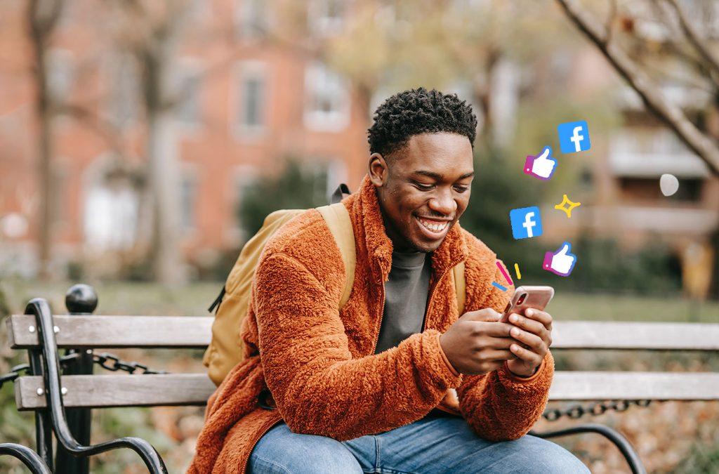 Man looking at social media on his phone