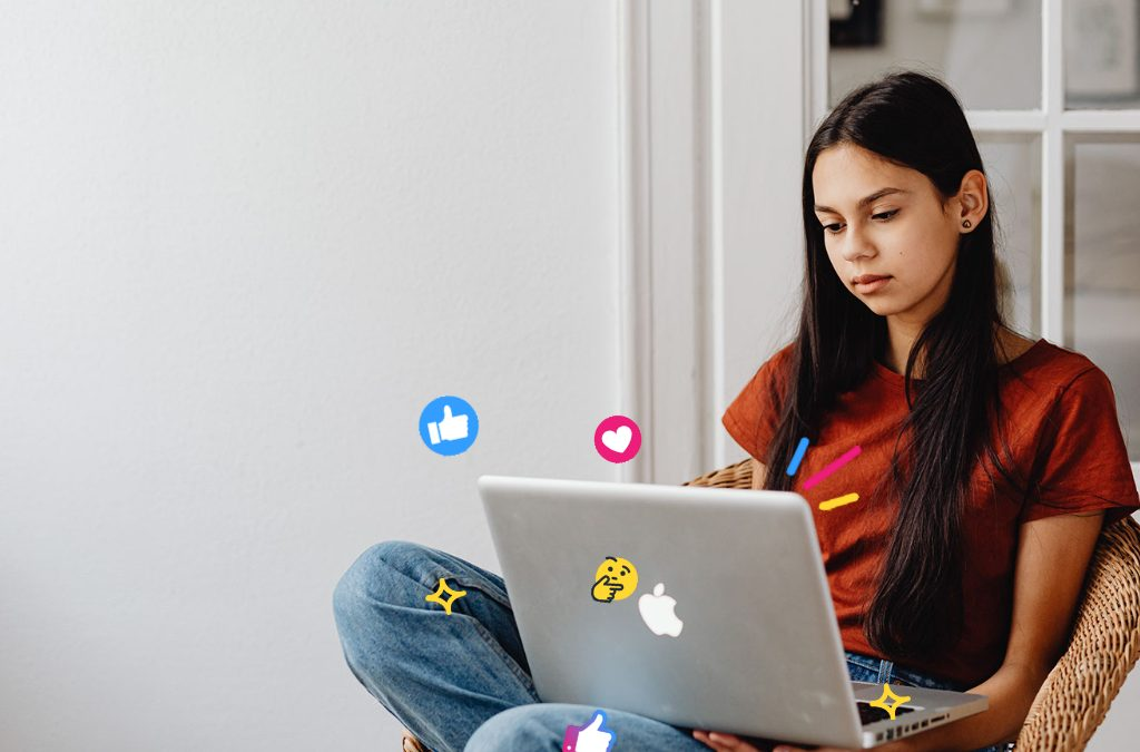 Girl reading our SEO Jargon Buster on her Apple MacBook